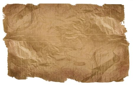 Piece of brown paper, torn on white background photo
