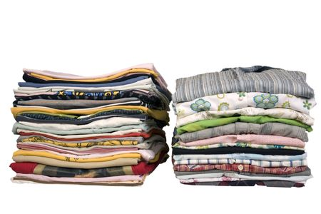stack of colored t-shirts and shirt, front view, ironed and packed Stock Photo
