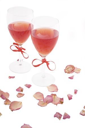 two red wine and rose petals on white background Stock Photo - 7305778