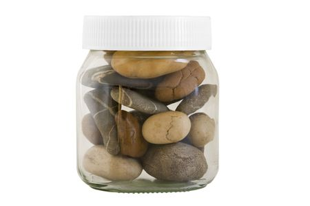 glass containers: transparent jar with different stones on white background