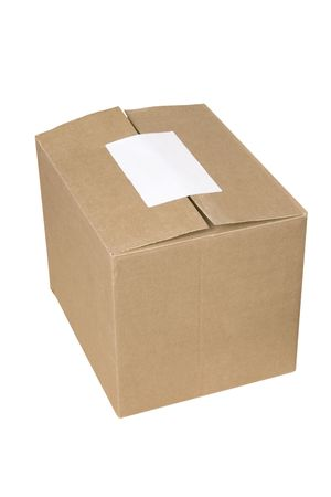 isolated closed shipping cardboard box whit white empty label photo