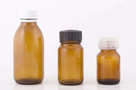 linctus: three brown small bottles on white background Stock Photo