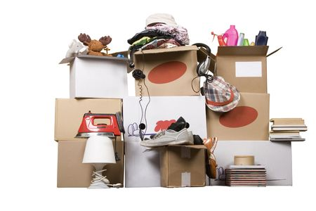 moving crate: transport cardboard boxes with books and clothes, relocation concept Stock Photo