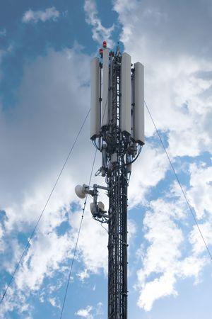 antena: Cellular communication antena and blue sky background Stock Photo