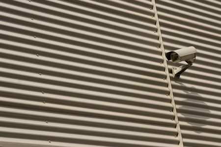 detail of surveillance camera mounted on metal facade Stock Photo - 7670763