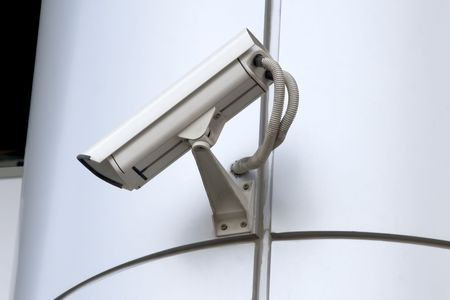 detail of surveillance camera mounted on metal facade photo
