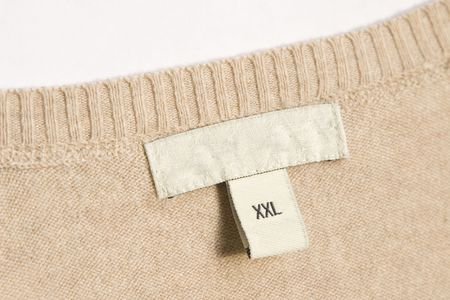 close-up of clothing label with xxl size photo