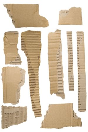 Pieces of torn brown corrugated cardboard, Isolated on White Background photo