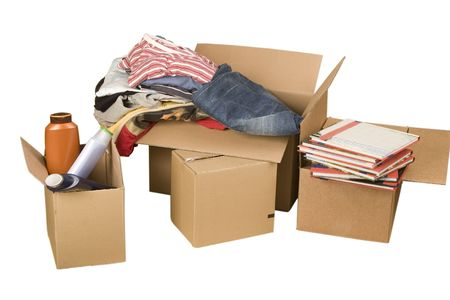 cardboard house: transport cardboard boxes with books and clothes on white background