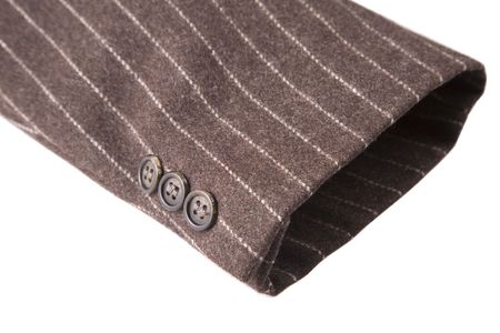 suit  cuff: closeup of suit, detail of brown cuff on white background