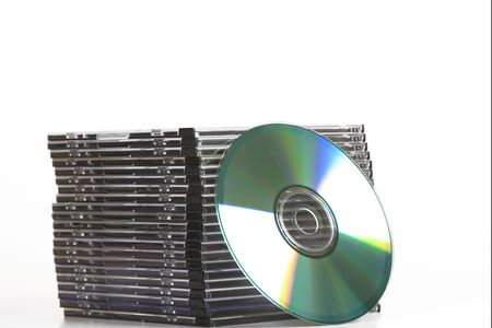 tower of cd dvd case  on white background photo