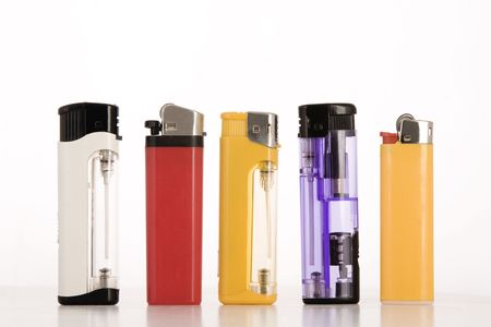 front view of colored lighters on white background photo