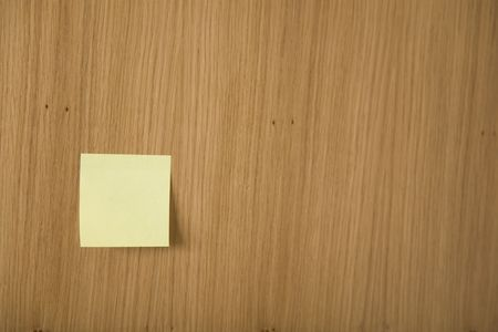 yellow post it on wooden board photo
