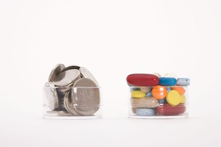 money and colored pills on white background photo