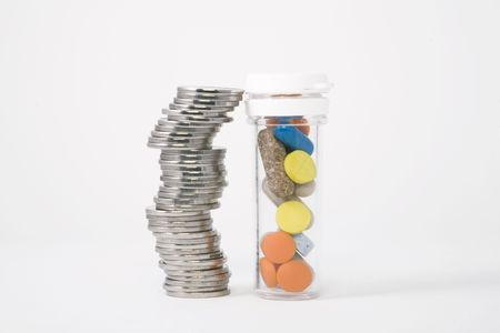 piled up money next to a bottle of colored pills photo