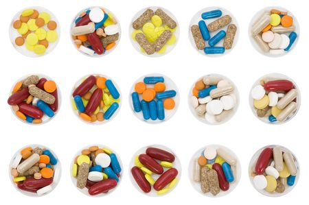 differently: differently colored and shaped pills on white background Stock Photo