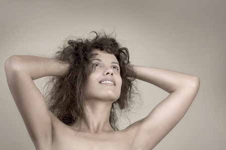 Beautiful face of young woman with clean skin. Girl with long curly hairs. Stock Photo - 8288536