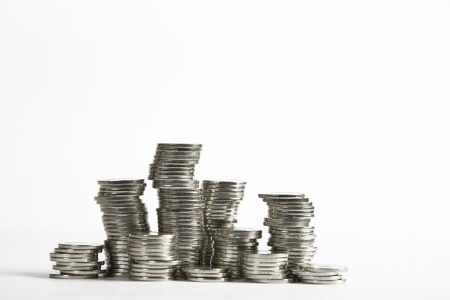 Stacks of silver coins on white background photo