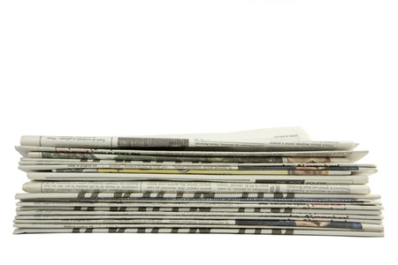 front view of piled up newspapers isolated on a white background  Stock Photo - 8288553