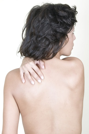 Woman massaging upper back pain, isolated on white background Stock Photo - 8341390
