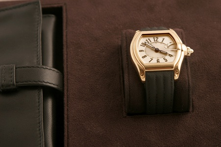 front view of black strap and gold watch