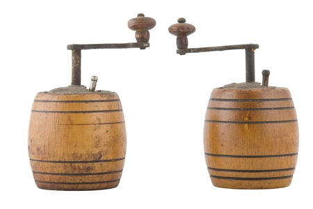 two vintage brown grinder, wooden made, on white background photo