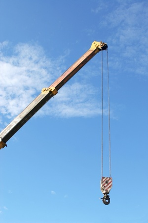 Crane with hook on blue sky background  Stock Photo - 8457481