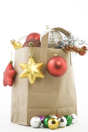 Christmas items in shopping  bag on white background photo