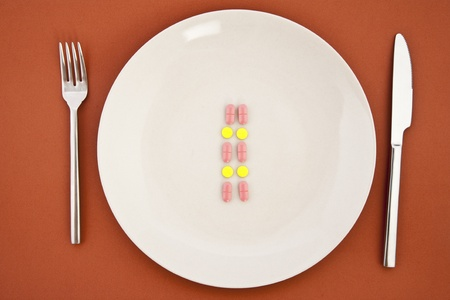 a meal of different tablets with silverware photo