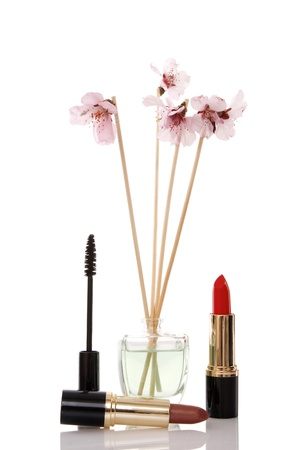 cosmetics, parfume and flower on white background photo