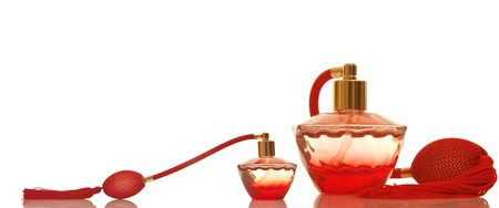 Perfume in a red glass bottles on white background