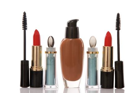 red lipstick and cosmetics on white background, beauty concept photo