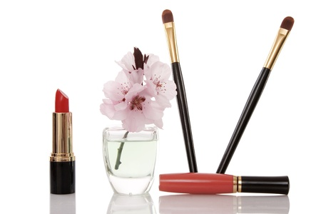 cosmetics and cherry flower on white background photo
