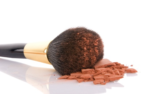 dry brush: Make-up brush and brown powder isolated on white background