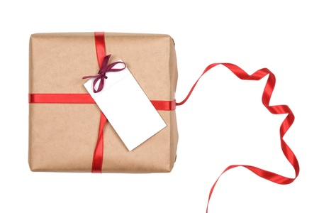 gift box with red ribbon and blank label on white background Stock Photo - 9463552