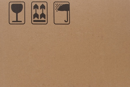 product box: close-up of grunge black fragile symbol on cardboard