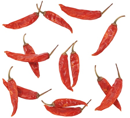 chilly: few dry red pepper on white background