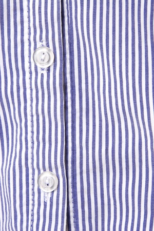 dry cleaned: white and blue striped shirt, button detail Stock Photo