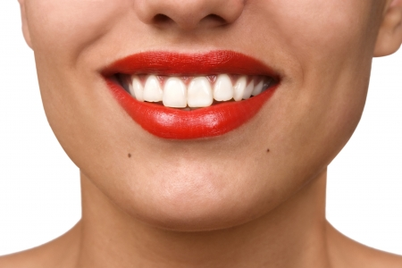 Smiling woman mouth with great white teeth. Over white background photo