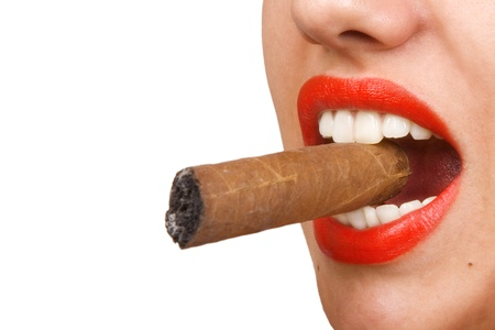 Smoking woman, mouth with red lips biting a cigar, selective focus photo