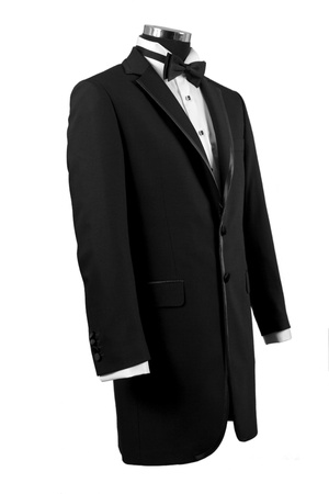 attire: Front view of black tuxedo and white shirt