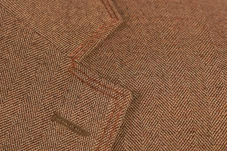 close-up of brown elegant buttonhole suit, textile classic photo