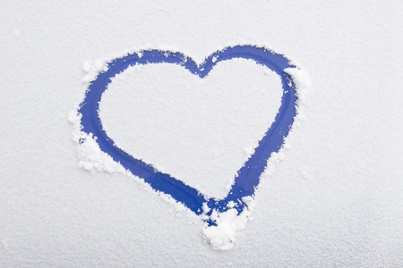 Heart shape drawn on white snow, love symbol for Valentine Day  Stock Photo - 9725000