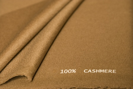 close-up of brown cashmere fabric, high quality textile photo