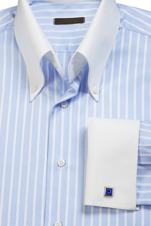 Close-up of cufflink on blue striped shirt