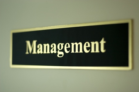 decission: management word with selectiv focus on office door