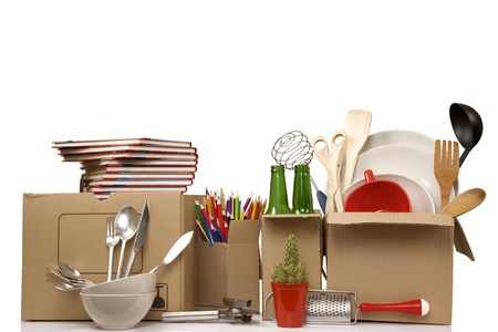 Transport cardboard boxes with books and clothes, relocation concept Stock Photo