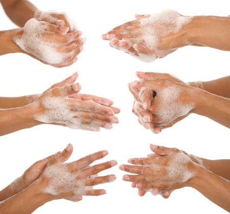 soaping: gesture of a beautiful womans hand washing her hands