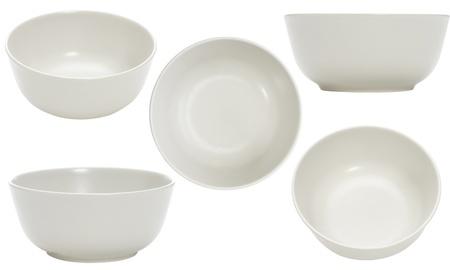 comiendo cereal: cinco punto de vista del recipiente vac�o sobre fondo blanco Foto de archivo