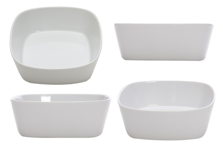 four empty bowls on white background photo